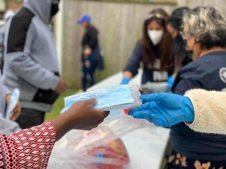 RxBIO Providing masks during a Thanksgiving event
